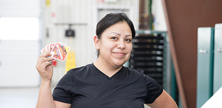 kwik lok employee holding labels